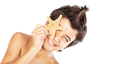 model fish: Happy face cute boy with starfish, closeup portrait of preteen brunette child, male kid model having fun, isolated on white background, summer travel and beach vacation