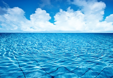 Endless pool water with blue sky background, fresh natural landscape, rippled texture and pattern, swimming pool seamless surface, summer travel vacation and spa leisure concept  photo