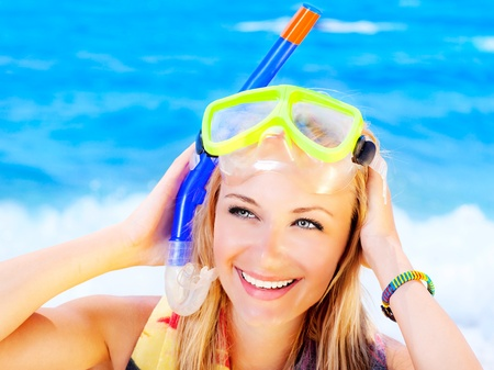 Pretty teen girl closeup portrait on the beach, summer fun outdoor, woman wearing snorkeling mask, female having fun, playing  water sport, active lifestyle, vacation concept photo