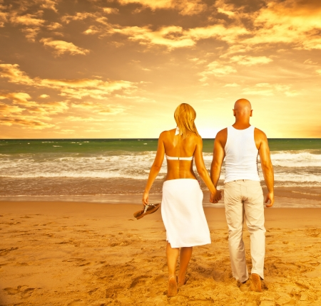 Happy couple on the beach, romantic travel, honeymoon vacation, summer holidays, people walking on sea sunset and holding hands, loving family relaxing outdoor, love concept photo