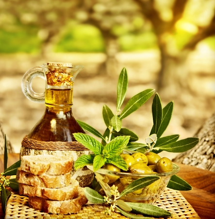 Olives still life, fresh food in garden of olive trees, farm land at countryside of Lebanon, homemade healthy olive oil and bread, harvest time photo