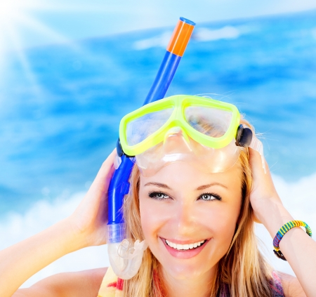 Pretty teen girl closeup portrait on the beach, summer fun outdoor, woman wearing snorkeling mask, female having fun, playing  water sport, active lifestyle, vacation concept Stock Photo - 13619010