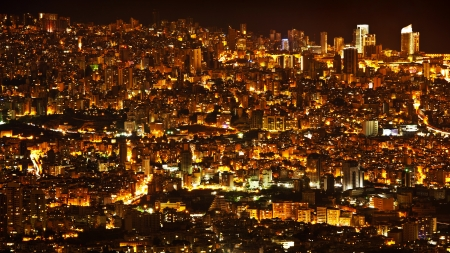 bird's eye view: Night city background, beautiful urban cityscape, Beirut with street lights, high buildings and skyscrapers,panoramic dark town pattern, Middle East , Lebanon