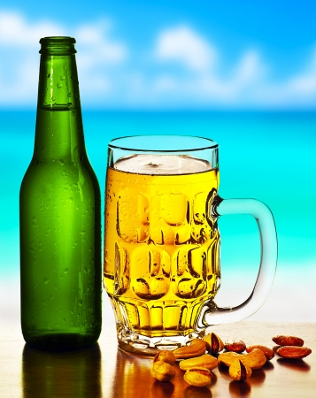 Cold beer on the beach, refreshing alcoholic drink with nuts mix, food and beverage still life, outdoor cafe,  summer leisure, vacation travel and fun concept photo