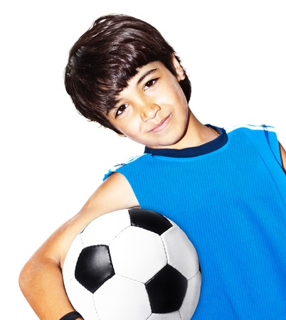 Cute boy playing football, happy child, young male teen goalkeeper enjoying sport game, holding ball, isolated portrait of a healthy preteen having fun, kids activities, little footballer photo