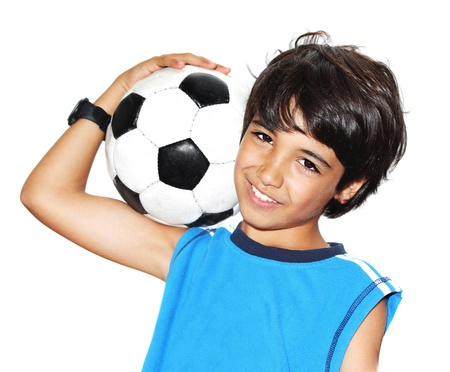 sport kids: Cute boy playing football, happy child, young male teen goalkeeper enjoying sport game, holding ball, isolated portrait of a preteen smiling and having fun, kids activities, little footballer