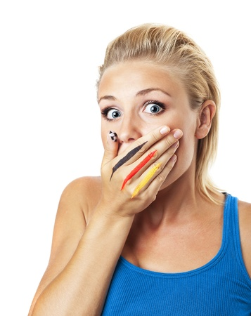 supporter: Worried football fan, female covering mouth with painted in flag colors hand, expressing fear and disappointment, young girl isolated on white background, German team supporter, stressed woman gesture Stock Photo