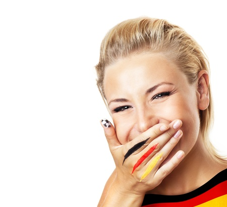 Smiling football fan, closeup on face, female covering mouth with painted in flag colors hand, woman expressing emotions of joy, German team supporter, girl watching game, isolated on white background photo