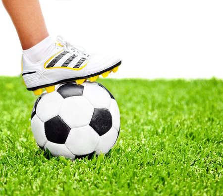 training shoes: Football player, men foot on the ball, playing sport game at outdoor stadium, green grass field, isolated on white with text space, conceptual image of competition, goal and healthy active lifestyle