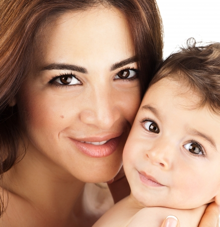 Mother and baby closeup portrait, happy faces, Arabic family picture, adorable small boy, mom and kid having fun indoor, parents joy, holding little child, healthy toddler and mommy, happiness concept photo