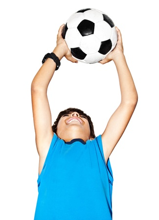 Happy jumping boy, cute kid playing football, active child, young male teen goalkeeper enjoying sport game, catching ball, isolated closeup portrait, preteen smiling and having fun, little footballer photo