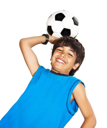 kids  soccer: Cute boy playing football, happy child, young male teen goalkeeper enjoying sport game, holding ball, isolated portrait of a preteen smiling and having fun, kids activities, little footballer