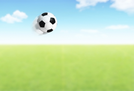 football object: Football ball flying over field, competitive team sport, open play space, green grass stadium outdoor, action slow motion, concept background of games and active lifestyle Stock Photo