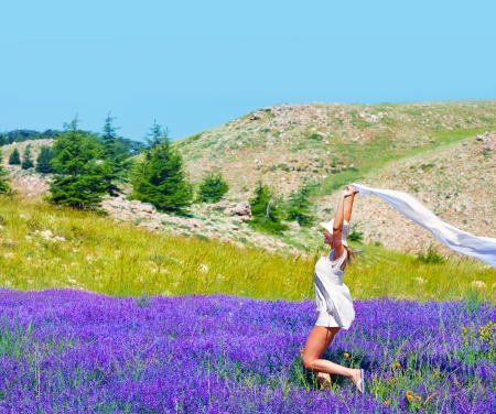 Beautiful girl dancing on lavender field photo