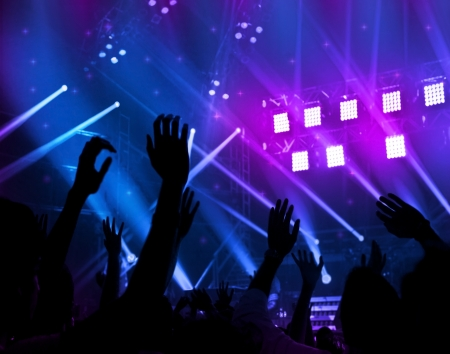 Party background, colorful abstract light, border made of human hands silhouette, happy people jumping large group celebrating new year holiday, men enjoying live band music at night club, fun concept
