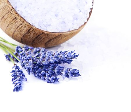 Fresh lavender flowers and wooden bowl with salt isolated on white background, beautiful purple floral still life, conception of aromatherapy, day spa, herbal treatment, natural cosmetics photo