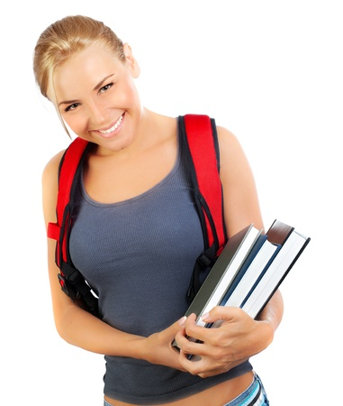 Happy student closeup, cute girl holds books, portrait of a pretty casual teen with big cheerful smile, young female isolated on white background, education and back to school concept, youth lifestyle Stock Photo - 14686570