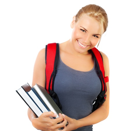 Happy student closeup face, cute girl holds books, portrait of a pretty casual teen with big cheerful smile, young female isolated on white background, education and back to school concept, youth lifestyle Stock Photo - 14686549