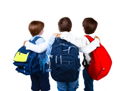 preteen boys: rear view of three teenager with colorful backpacks Stock Photo