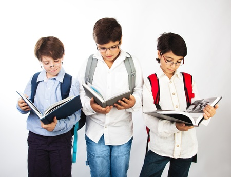 Happy schoolboys reading photo