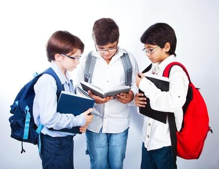 Three smart boys read books photo