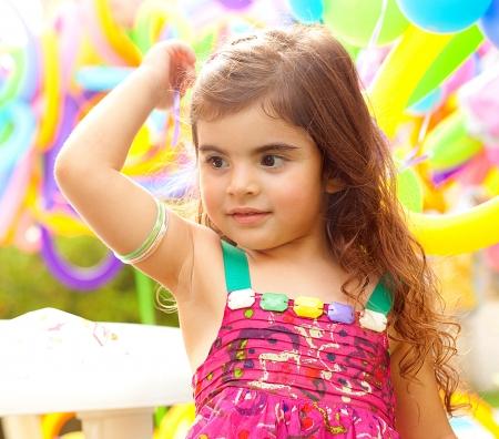Closeup portrait of playful sweet small female child photo