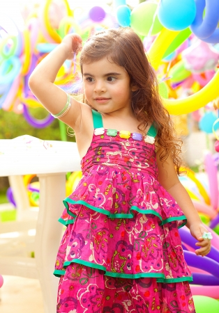 Beautiful little girl on birthday party photo