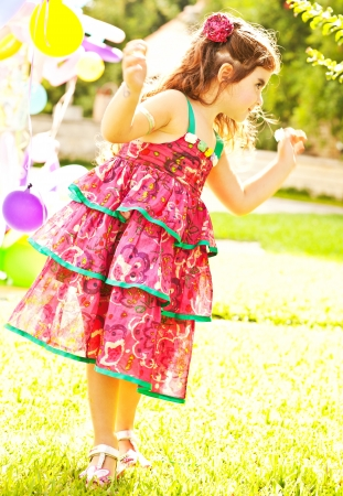 Nice small girl dancing outdoors photo