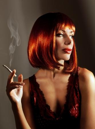 Beautiful woman smoke cigarette Stock Photo