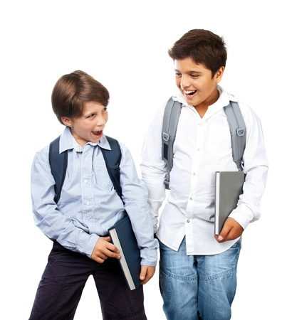 Two happy schoolboys isolated on white background photo