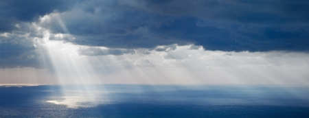Bright sunlight over ocean, beautiful shine sun beam in sky, abstract blue natural background, peaceful skyscape, open heaven and God, morning sun rays, mediterranean resort, panoramic sea photo