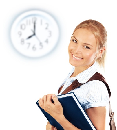 Portrait of beautiful happy student female, attractive clever smiling school girl with textbook isolated on white background, pretty smart cheerful teenager and clock on wall, education concept photo