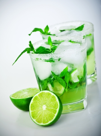Cold mojito drink, glass of icy alcohol refreshing booze, tasty Cuban alcoholic cocktail made of fresh mint leaves and lime fruit, food and beverage still life, party and holidays celebration photo