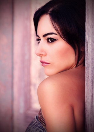 dark side: Closeup portrait of beautiful woman, attractive young lady with stylish sexy makeup posing outdoor, side view of fashionable glamorous brunette female, vintage style image, beauty concept   Stock Photo