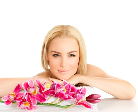 Portrait of pretty woman enjoying dayspa, picture of young beautiful lady with pink orchid flower isolated on white background, zen balance, beauty treatment, luxury spa ralaxation photo