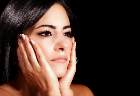 Closeup portrait of attractive arabic woman isolated on black background, glamorous beautiful female touching face by hands, sexy brunette girl with stylish makeup, beauty concept Stock Photo - 15238294