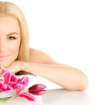 Photo of half woman face, beautiful young lady in spa, cute female enjoying aromatic massage, good looking girl with pink orchid flowers isolated on white background, spa relaxation concept photo