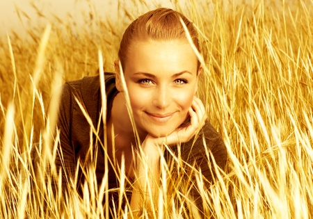 Image of pretty cute woman on wheat field, sweet lovely female enjoying freedom in countryside, golden hay meadow, autumn nature, attractive blond girl on wheat rye background, grain harvest season  photo