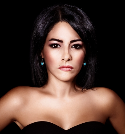 Photo of beautiful sexy woman isolated on black background, closeup portrait of stylish glamorous female, attractive brunet young lady with fashionable makeup, elegant arabic model  Stock Photo - 15427417