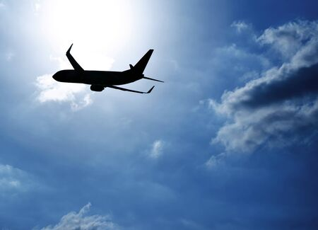 airplane take off: Picture of silhouette airplane in blue sky, journey trip, airliner in heaven, plane over clouds background, air transportation, luxury airline, business destination, fast flight, tourism concept