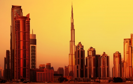 dubai city: Picture of dubai downtown on sunset, arabian architecture, modern landmark,luxury building, burj khalifa in evening, beautiful cityscape in middle east, united arab  emirates