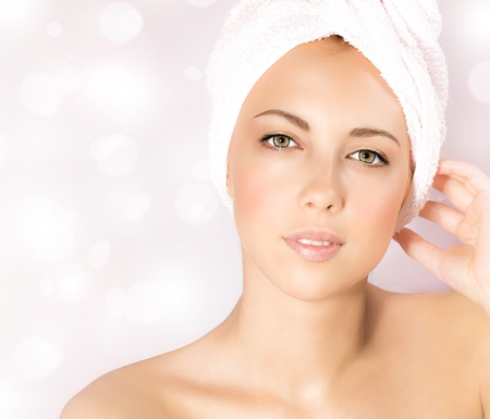 Image of pretty woman in luxury spa salon, close up portrait of cute female isolated on pink blur glowing background, attractive young lady with perfect skin enjoying dayspa, beauty treatment