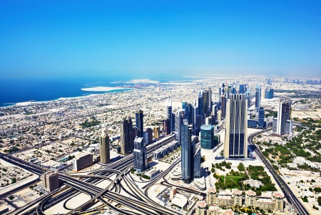 middle east: Image of Dubai downtown, top view of Dubai city, business industry, luxury buildings, united arab emirates, arabic urban street, cityscape, conceptual of tourism and vacation  Stock Photo
