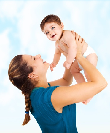 mom holding baby: a young beautiful mother with cute baby boy