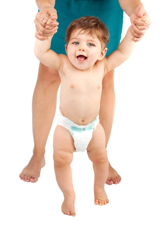 Picture of cute baby boy making his first step    photo