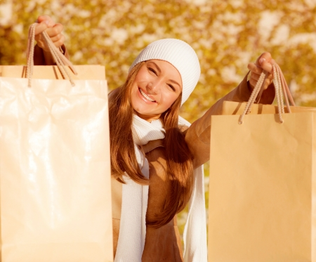 a cute cheerful girl with shopping bags  photo