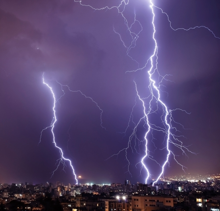 Photo of beautiful powerful lightning over big city, zipper and thunderstorm, abstract background, dark blue sky with bright electrical flash, thunder and thunderbolt, bad weather concept    photo