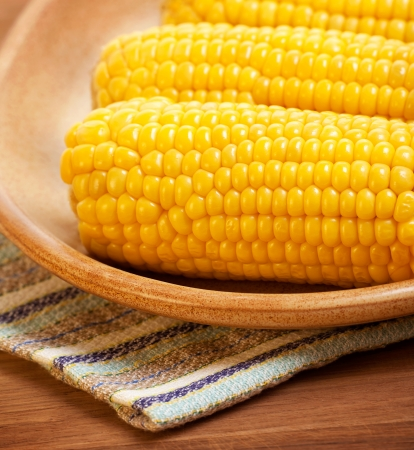 sweetcorn: Photo of boiled sweetcorn on the plate in kitchen, tasty healthy cusine, prepared corn with salt, vegetarian meal, organic food, cooked cob of fresh yellow maize, cooking vegetable Stock Photo
