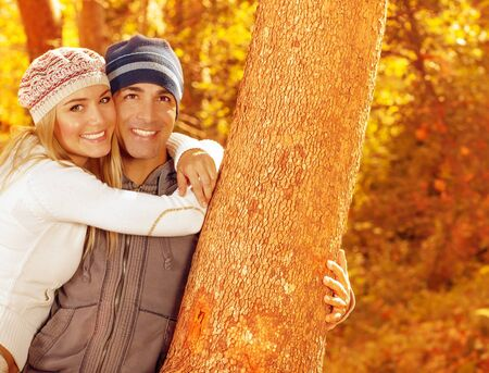Picture of happy people spending fun time together in beautiful autumn park, closeup portrait of attractive female and handsome male smiling, young adult couple enjoying outdoor, love concept Stock Photo - 16010581