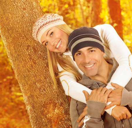 Photo of happy couple hugging each other in autumn park, young family enjoying fall weather, wife and husband spending leisure time together outdoors, romantic relationship, love concept Stock Photo - 16010613